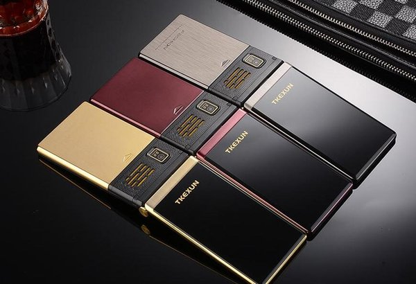 Original TKEXUN M2 Flip teléfono celular Cuerpo de metal Senior Luxury Dual Sim Cámara MP3 MP4 3.0 Pulgadas Pantalla táctil Teléfono móvil