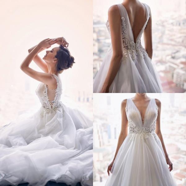 Robes de mariée sur la plage de Bohême 2019 Dentelle Appliquée Perles Deep V Neck robes de mariée dos nu Boho Tulle robe de mariée plage Robe De Mariée