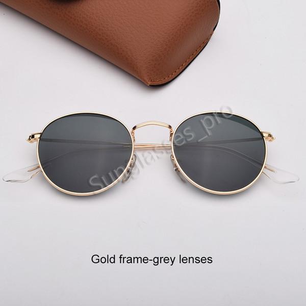 Золотая рамка-серые линзы