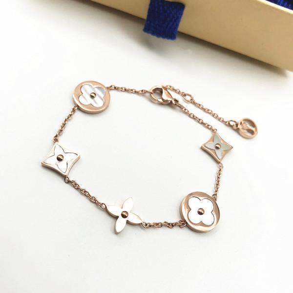 Япония и Южная Корея Новая мода Luxury Four-лист дамы Строчка браслет розовое золото Белый Shell Texture Браслет ювелирных изделий