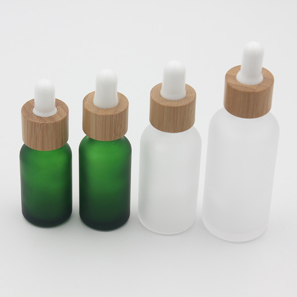 top popular Frost Clear Glass Dropper Bottle 15ml 20 30ml with Bamboo Lid Cap Essential Oil Bottles Frosted Green 2021