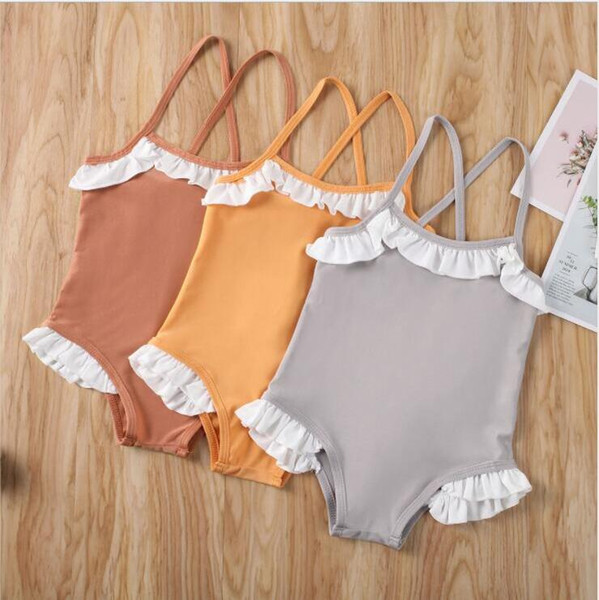 top popular Baby Girls Swimsuit Kids Suspender Bikini One-Pieces Child Falbala Ruffle Solid Swimwear Baby Summer Bathing Suit Fashion Beachwear CYP635 2021