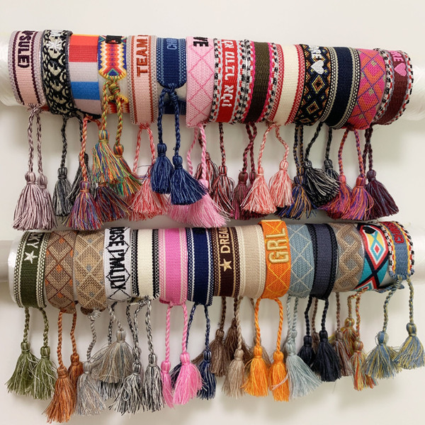 best selling Luxury style rope material woven bracelet with sewing words and tassel hand strap brand jewelry for women gift