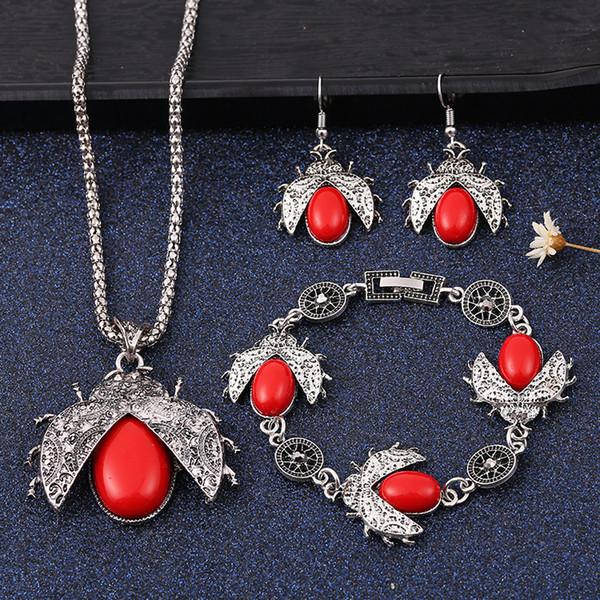 2019 gros ensemble de bijoux rétro sept étoiles coccinelle trois pièces ensemble collier boucle d'oreille bracelet pour accessoire de bijoux pour femmes