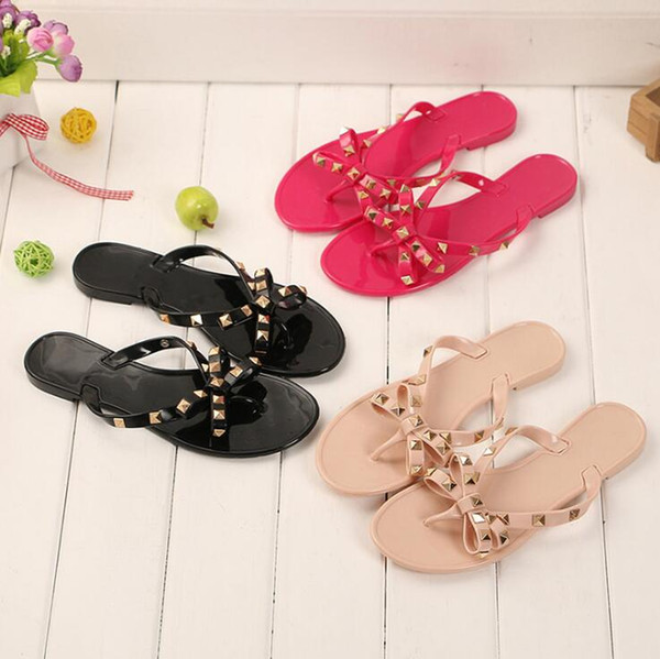 2019 Sexy Black Flat Woman Summer Sandals Rivets Big Bowknot Flip Flops Beach Sandalias Femininas Flat Jelly Designer Sandals N018