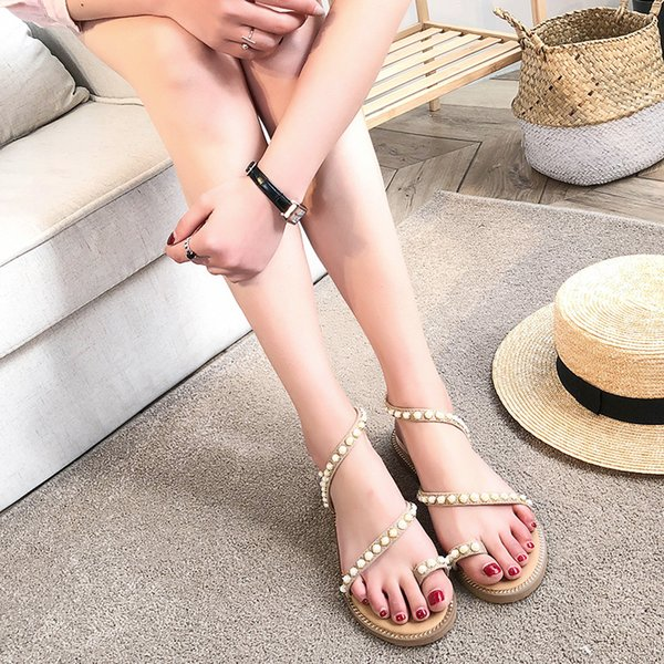 Summer new European and American wild flat women's shoes fashion trend Roman style beach women's shoes String Bead