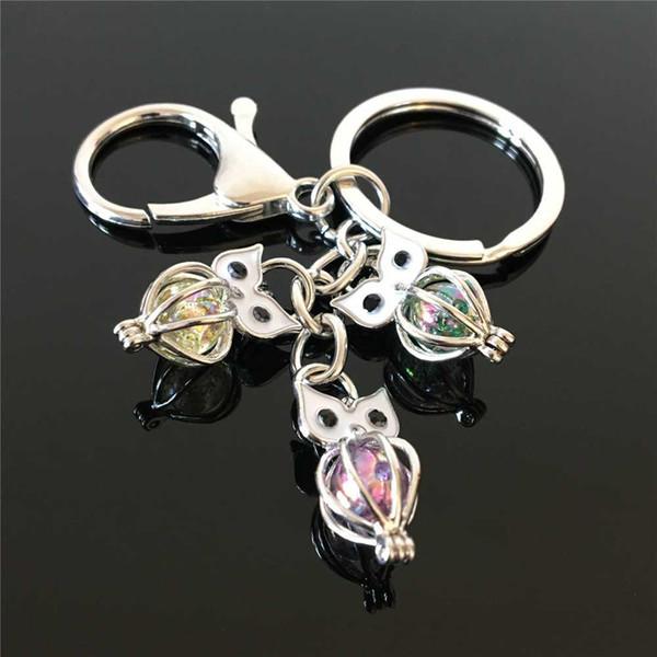 O porta-chaves da gaiola da pérola da coruja popular euro-americano pode abrir a pérola oca pérola noctilucente pérola pedra vulcânica chaveiro