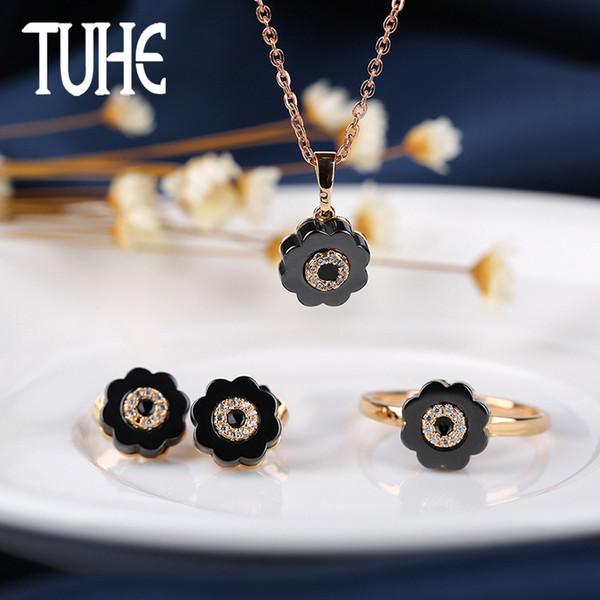 Nuevo estilo de forma de flor de cerámica niña joyería conjunto negro blanco pendientes elegantes anillo de moda para regalos de amor regalos de Navidad