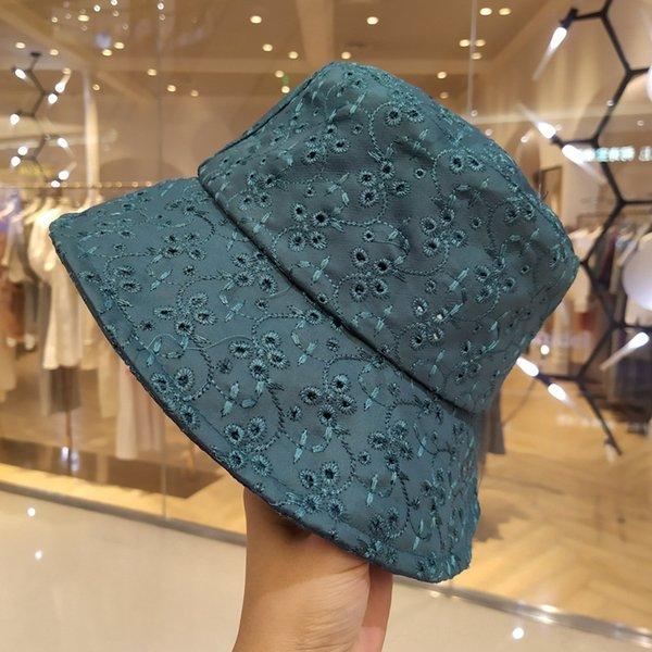 paon chapeau bleu pêcheur