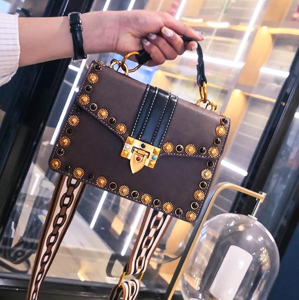 Small bag woman 2018 new tidal rivet handheld single shoulder bag Korean wide band oblique satchel Xiao Fang bag