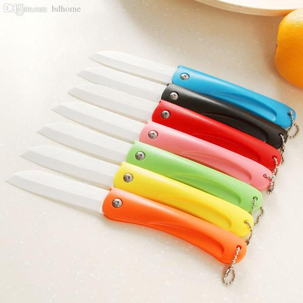 Al por mayor-Nuevo mini cuchillo de cerámica del regalo del cuchillo de bolsillo de cerámica de los cuchillos plegables de cocina Cuchillo de pelado de frutas con mango de ABS colorido