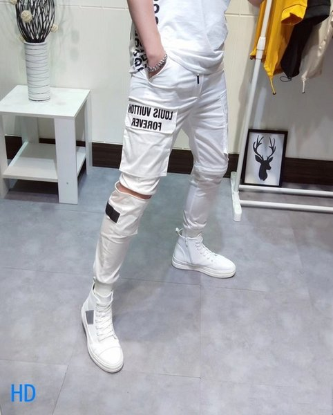 2019 Nuovo modello pantaloni casual pantaloni sportivi maschili Slim e piccoli piedi pantaloni sportivi coreani edizione ricamo e squisito 34