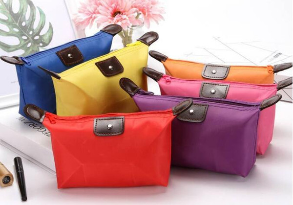 top popular Top Quality Lady Sport MakeUp Pouch Waterproof Cosmetic Bag Clutch Toiletries Travel Kit Casual Small Purse Candy 10 Colors 2021