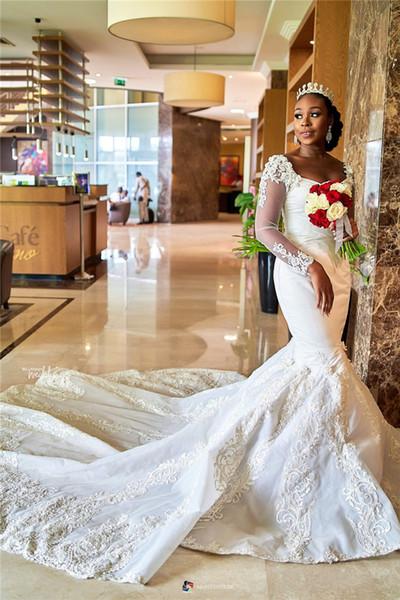 2019 Afrikanische Sexy Long Sleeves Meerjungfrau Hochzeitskleid Elegante Schwarze Mädchen Spitze Applizierte Gericht Zug Plus Size Brautkleid