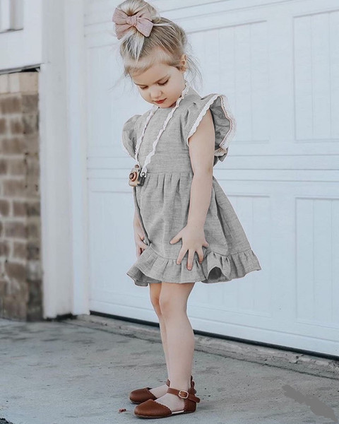 les filles de bébé Bowknot à volants tunique robe col rond dentelle fille jupe bowknot sling dos nu jupe filles vêtements en gros