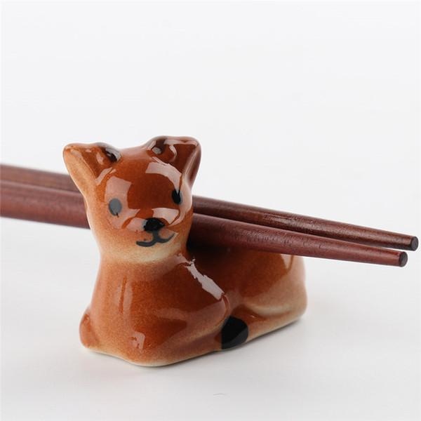 1pcs Chopsticks Détenteurs chien mignon prune Cher Forme chinos céramique palillos céramique Rest rack Couverts Cuiller Fourchette stand