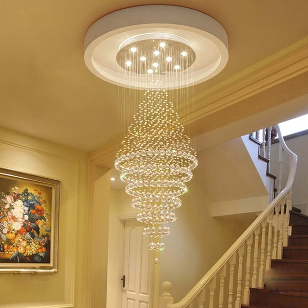 Crystal chandelier in the lobby of the building. Duplex stairwell. Villa light. K9 clear crystal. Mirror stainless steel chassis. LED light