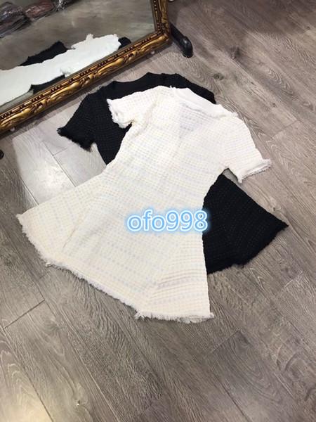 Women v-neck knit a-line dress knitwear knitted shirt dress 2019 summer hollow out tassel short sleeve knitted dress slim mini dresses