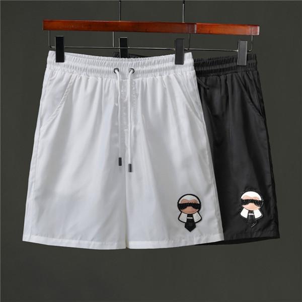 Pantalones cortos de verano para hombres Pantalones de playa con pantalones cortos de tiburón Camuflaje Pantalones de moda Letras Hasta la rodilla Pantalones sueltos M-3XL