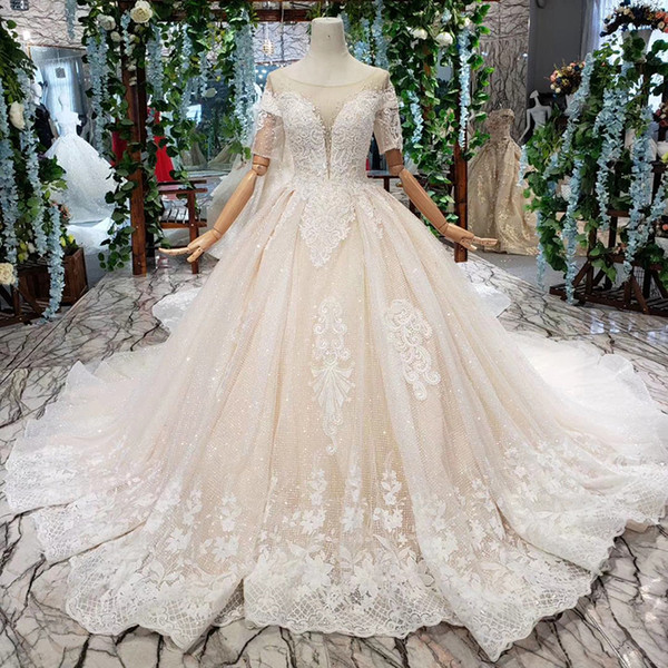 2019 Latest Lebanon Wedding Dresses Short Sleeve Illusion O Neck Open Keyhole Lace Up Back Sequins Applique Pattern Crystal Bridal Gowns