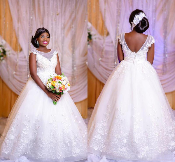 Plus Size African Wedding Dresses 2019 Lace Appliques Capped Sheer Neck Ball Gowns Backless Lace Up Floor Length Wedding Dresses