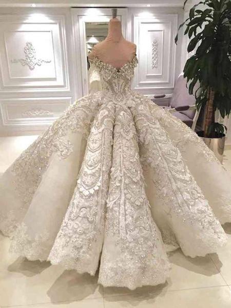 2019 Luxe Dubai robe de mariée robe de bal l'épaule cristaux scintillants perles dentelle Appliques arabe robes de mariée avec le long train