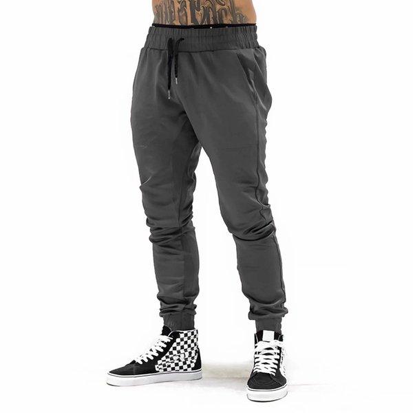 calças cinza