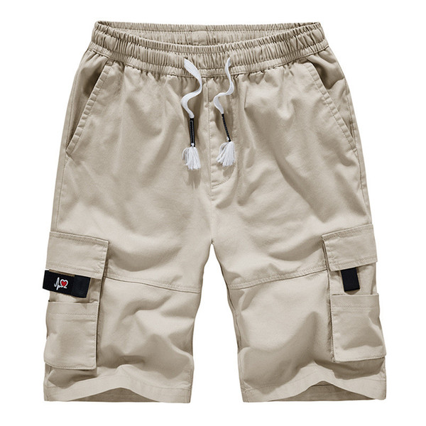 Diseñador Hombres Trajes de marca Trajes de hombre Marea de la marca Pantalones sueltos de múltiples bolsillos Pantalones cortos de cinco hombres Pantalones cortos para hombres Pantalones de playa de verano