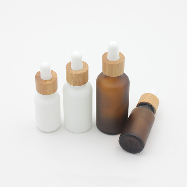 top popular 15ml 30ml 50ml Frosted Amber White Glass Dropper Bottle with Bamboo Cap 1oz Glass Bamboo Essential Oil Bottle 2021