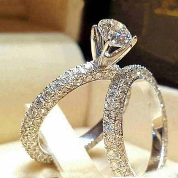 top popular Stainless Steel Wedding Ring For Lovers IP SILVER Color Crystal Couple Rings Set Men Women Engagement Wedding Rings 2021