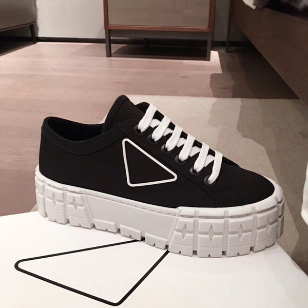 top popular rubber platform inspired by motocross tires defines the unusual design of these nylon gabardine sneakers. The logo triangle decorate50 mm 2021