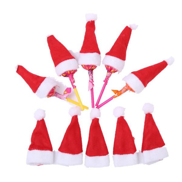20pcs lindo de Santa Claus Mini Red Hat para obtener Lollipop del caramelo de la decoración de Navidad de la Navidad DIY regalo Lollipop Top Topper cubierta decoración del festival