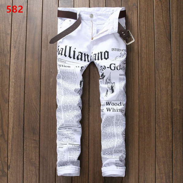 2019 Men's wear white motorcycle jeans personality newspaper graffiti style stitching slacks jogging pants fashion designer bike slim pants