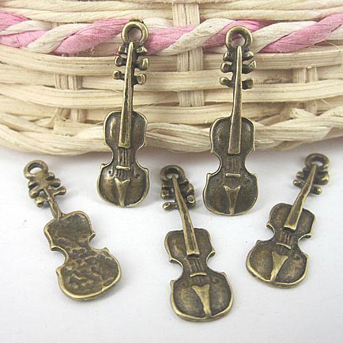 bronze antique pendentif instrument de musique charme G576