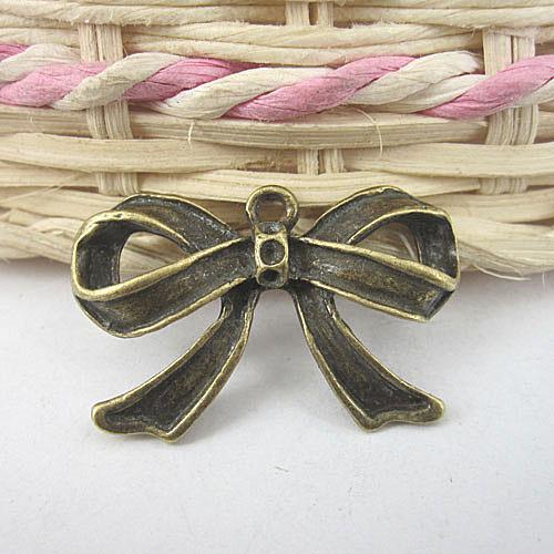 Ciondolo pendente G603 in bronzo anticato con pendente bowknot di bronzo 10 pezzi