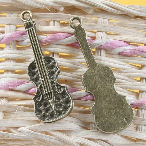 anticato musica bronzo ciondolo strumento fascino G665