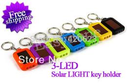 solarbetriebenes geführtes keychain Rabatt Großhandels-Freies Verschiffen !!! Portable Mini 3 LED ÜBERLEBEN Solar Power Taschenlampe Licht Keychain 8 Farben