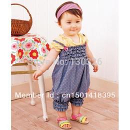 pantalones vaqueros Rebajas Al por mayor-Primavera 2015 niños pantalones vaqueros en general ropa de bebé recién nacido monos de mezclilla para niños / bebés niñas pantalones
