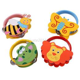 Wholesale Tambourine Pattern - Wholesale-Baby Tambourine Toys Instrument Cartoon Pattern kid Shaking Handbell Rattles Wooden Free Shipping