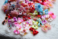 Wholesale new products for hair - 2015 New Wholesale Mix Styles 200pcs lot Top Quality Pearls Style dog bows pet hair bows for Festival dog hair grooming products
