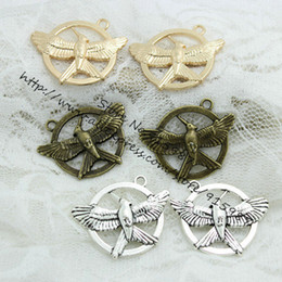 Wholesale Hunger Games Charms - Wholesale-(20 pieces lot) 25*33mm Three Colors Plated Antique Metal Alloy The Hunger Game Charms Fit Jewelry Making Charms D0374