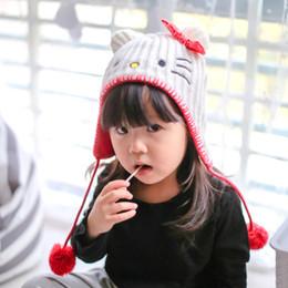 Kids Crochet Beanies Canada - Wholesale baby cat hat with sequins bowknot crochet baby warm beanies kids Fall Winter hat baby cap handmade knit windproof Earmuffs cap