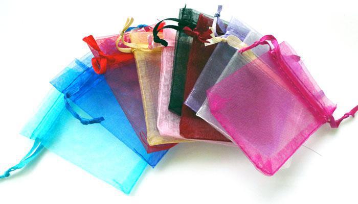 Groothandel 1000 stks / partij Organza Sieraden Bruiloft Gift Gunst Tassen Houders 7 * 9cm Douche Pouch Bruiloft Supplies Solid Color