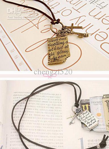 Säljer kvinnors små presenter halsband skulptur nyckelkedja kors tröja gratis frakt