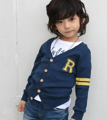 Up for sale is a baby boy's 6 month coat from Ralph Lauren new with tags. This coat is a yellow and navy blue color block with a navy horse and rider logo, a full zip and snaps on the front. It also has a warm down filling for warmth this winter.