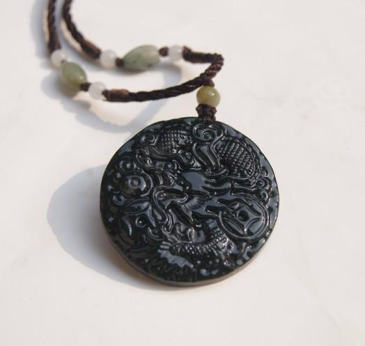 Natural dark green jade. Amulet pendant.Round money Long .2012 Year of the Dragon