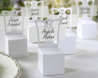 Wholesale free paper birthday cards resale online - Simple and Elegant white Wedding Candy boxes chocolate box white chair gift boxes with blank name cards