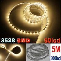 гибкие световые индикаторы оптовых-300led 3528 SMD Гибкие светодиодные полосы света теплый белый светодиодный плоский веревку свет не водонепроницаемый led освещение 5 м 60LED / м