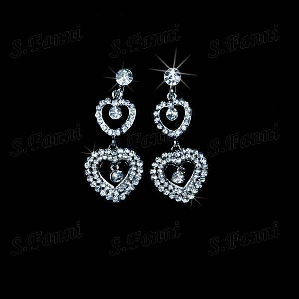 2019 Nuevo diseño de aretes de diamantes de imitación con aretes y collar de joyas Conjunto Bling Bling Lujoso