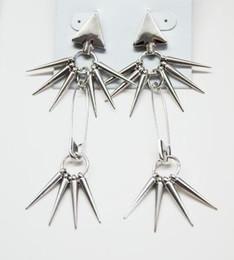 Ear Gun Studs Canada - New European Style Hot Punk Gun Black Rivet Hanging Tassel Triangle Ear Stud Earring women's jewelry